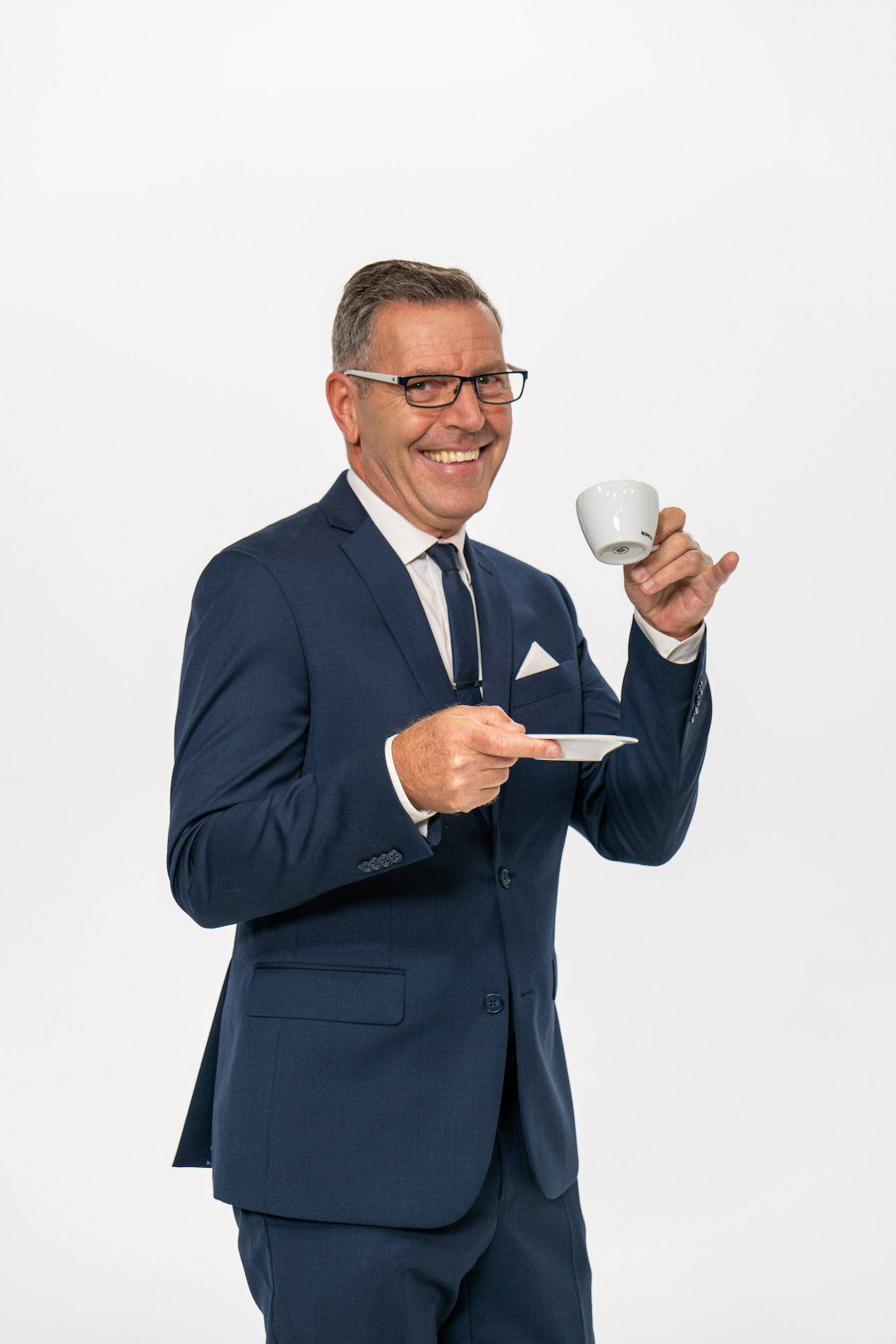 Mark Pickett in Blue Suit with tea cup