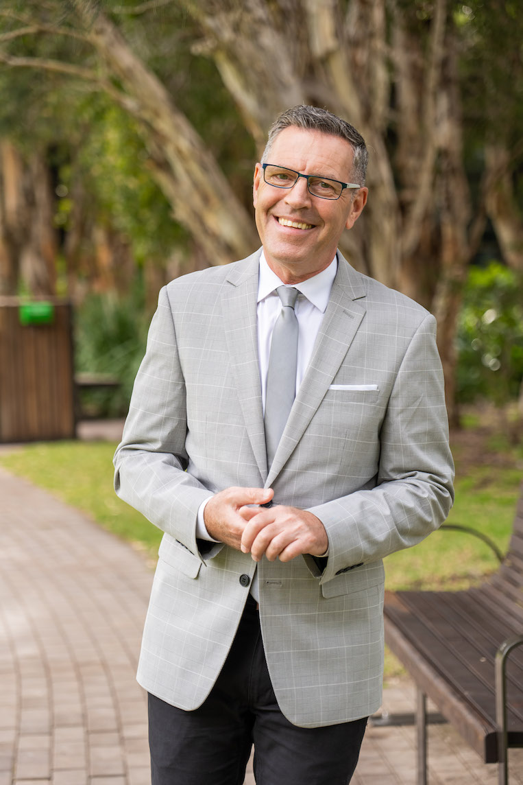 Mark Pickett in grey suit